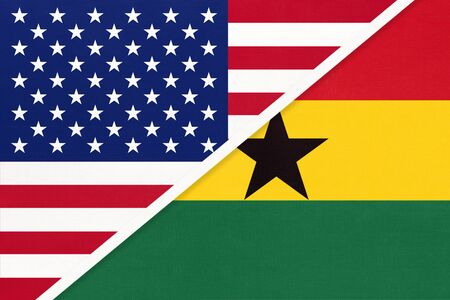 USA vs Republic of Ghana national flag from textile. Relationship, partnership and economic between two american and african countries.