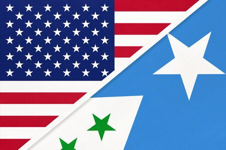 USA vs Galmudug State national flag from textile. Relationship, partnership and economic between two american and african countries. Imagens
