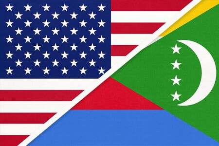 USA vs Union of the Comoros national flag from textile. Relationship, partnership and economic between two american and african countries.