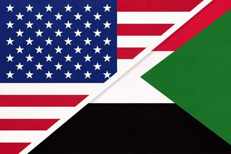 USA vs Republic of the Sudan national flag from textile. Relationship, partnership and economic between two american and african countries.