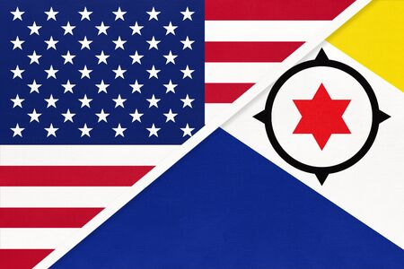 USA vs Bonaire island national flag from textile. Relationship, partnership and economic between two american and caribbean countries. Imagens