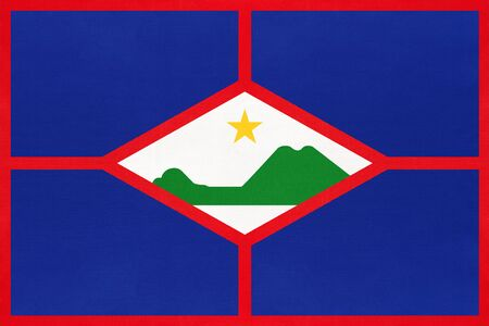 Sint Eustatius island national fabric flag, textile background. Symbol of international caribbean world country. American state official sign. Imagens