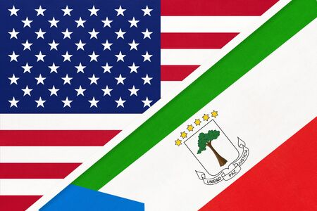 USA vs Republic of Equatorial Guinea national flag from textile. Relationship, partnership and economic between two american and african countries.