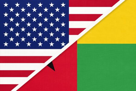USA vs Republic of Guinea Bissau national flag from textile. Relationship, partnership and economic between two american and african countries. Imagens