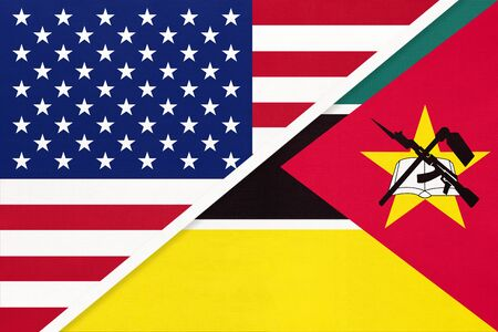 USA vs Republic of Mozambique national flag from textile. Relationship, partnership and economic between two american and african countries.