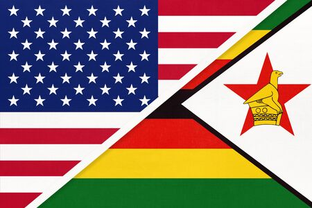 USA vs Republic of Zimbabwe national flag from textile. Relationship, partnership and economic between two american and african countries.