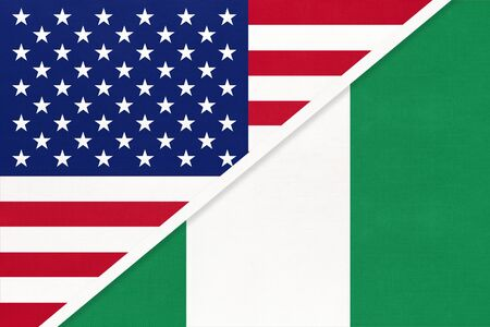 USA vs Federal Republic of Nigeria national flag from textile. Relationship, partnership and economic between two american and african countries. Imagens