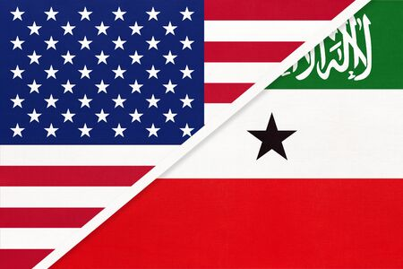 USA vs Republic of Somaliland national flag from textile. Relationship, partnership and economic between two american and african countries. Imagens