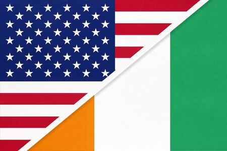 USA vs Ivory Coast national flag from textile. Relationship, partnership and economic between two american and african countries.