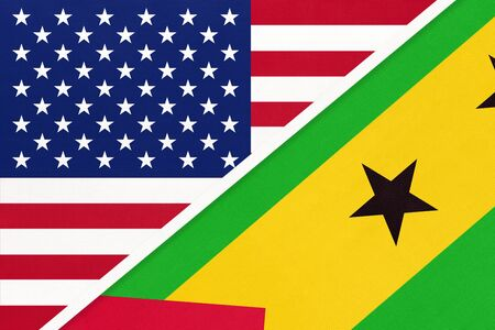 USA vs Democratic Republic of Sao Tome and Principe national flag from textile. Relationship, partnership and economic between two american and african countries. Imagens