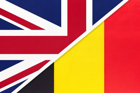 United Kingdom of Great Britain and Ireland vs Belgium national flag from textile. Relationship, partnership and economic between two european countries. Banco de Imagens