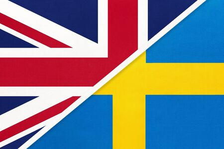 United Kingdom of Great Britain and Ireland vs Sweden national flag from textile. Relationship, partnership and economic between two european countries. Stock fotó - 138158369