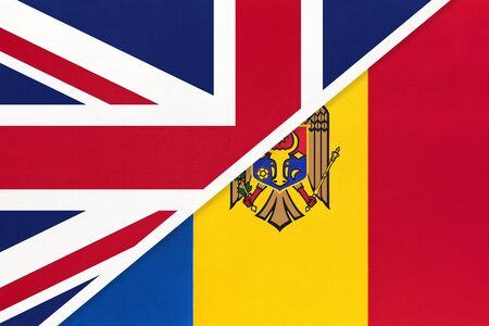 United Kingdom of Great Britain and Ireland vs Republic of Moldova national flag from textile. Relationship, partnership and economic between two european countries. Reklamní fotografie