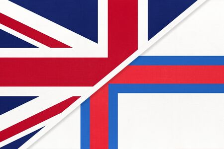 United Kingdom of Great Britain and Ireland vs Faroe Islands national flag from textile. Relationship, partnership and economic between two european countries. Banco de Imagens