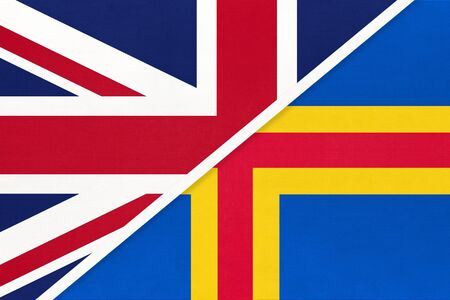 United Kingdom of Great Britain and Ireland vs Aland Islands national flag from textile. Relationship, partnership and economic between two european countries.