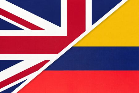 United Kingdom of Great Britain and Ireland vs Republic of Colombia national flag from textile. Relationship, partnership and economic between two european and american countries.