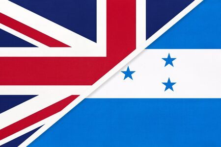 United Kingdom of Great Britain and Ireland vs Republic of Honduras national flag from textile. Relationship, partnership and economic between two european and american countries. Banque d'images