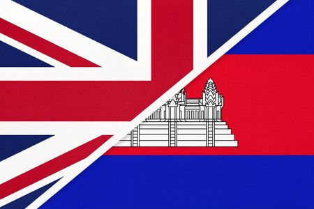 United Kingdom of Great Britain and Ireland vs Cambodia or Kampuchea national flag from textile. Relationship, partnership and economic between two european and asian countries. 写真素材