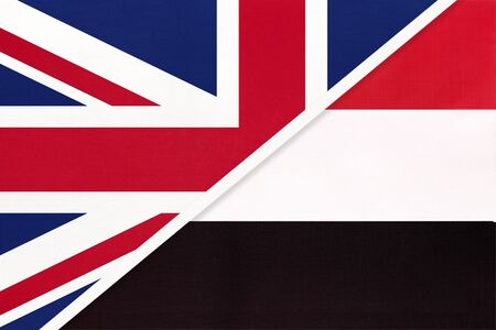 United Kingdom of Great Britain and Ireland vs Republic of Yemen national flag from textile. Relationship, partnership and economic between two european and asian countries.