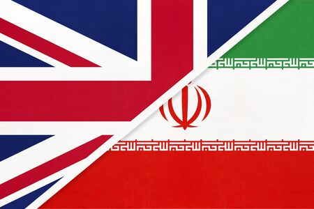 United Kingdom of Great Britain and Ireland vs Islamic Republic of Iran or Persia national flag from textile. Relationship, partnership and economic between two european and asian countries.