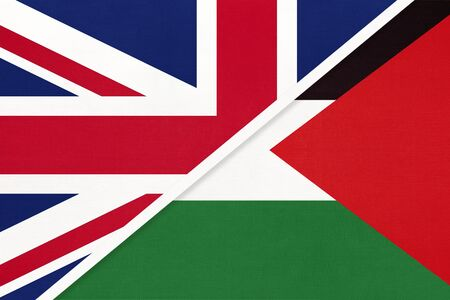 United Kingdom of Great Britain and Ireland vs State of Palestine national flag from textile. Relationship, partnership and economic between two european and asian countries.