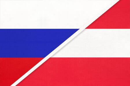 Russia or Russian Federation vs Republic of Austria national flag from textile. Relationship, partnership and economic between two european and asian countries.