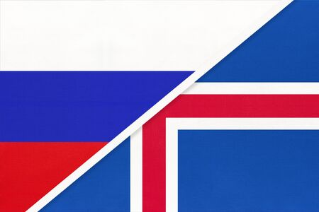 Russia or Russian Federation vs Iceland national flag from textile. Relationship, partnership and economic between two european and asian countries.