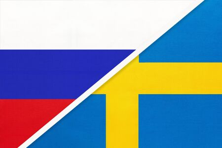 Russia or Russian Federation vs Kingdom of Sweden or Swedish national flag from textile. Relationship, partnership and economic between two european and asian countries.