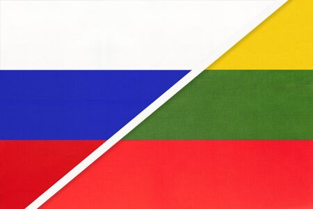 Russia or Russian Federation vs Republic of Lithuania national flag from textile. Relationship, partnership and economic between two european and asian countries.