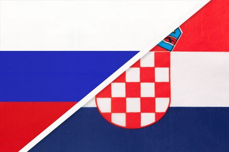 Russia or Russian Federation vs Republic of Croatia national flag from textile. Relationship, partnership and economic between two european and asian countries.