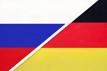 Russia or Russian Federation vs Federal Republic of Germany national flag from textile. Relationship, partnership and economic between two european and asian countries.