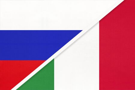 Russia or Russian Federation vs Italian Republic or Italy national flag from textile. Relationship, partnership and economic between two european and asian countries.