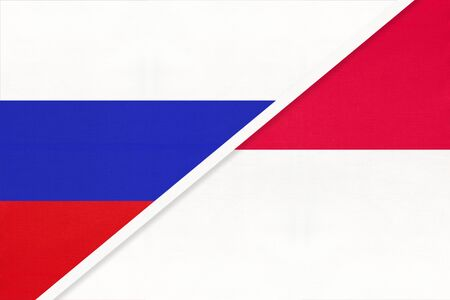Russia or Russian Federation vs Principality of Monaco national flag from textile. Relationship, partnership and economic between two european and asian countries.