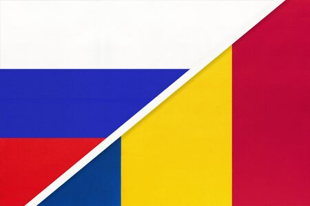 Russia or Russian Federation vs Romania national flag from textile. Relationship, partnership and economic between two european and asian countries.