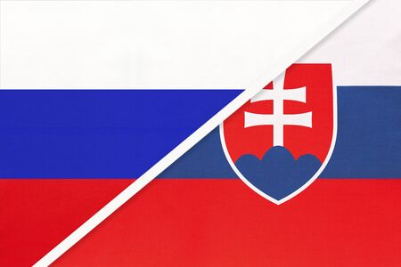 Russia or Russian Federation vs Slovak Republic or Slovakia national flag from textile. Relationship, partnership and economic between two european and asian countries.