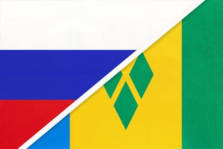 Russia or Russian Federation vs Saint Vincent and the Grenadines national flag from textile. Relationship, partnership and economic between two european and american countries. Banco de Imagens