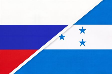 Russia or Russian Federation vs Republic of Honduras national flag from textile. Relationship, partnership and economic between two european and american countries.