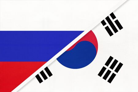 Russia or Russian Federation vs Republic of South Korea national flag from textile. Relationship, partnership and economic between two european and asian countries.