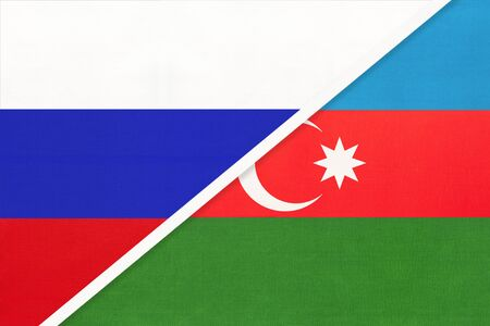 Russia or Russian Federation vs Republic of Azerbaijan national flag from textile. Relationship, partnership and economic between two european and asian countries.