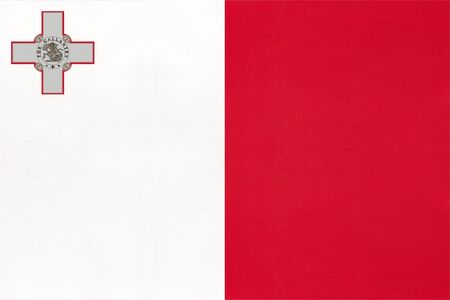 Republic of Malta national fabric flag with emblem, textile background. Symbol of international world european country. State official Maltese sign. 版權商用圖片