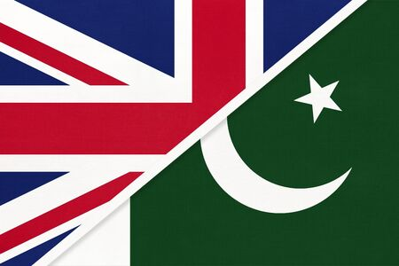 United Kingdom of Great Britain and Ireland vs Republic of Pakistan national flag from textile. Relationship, partnership and economic between two european and asian countries. 版權商用圖片