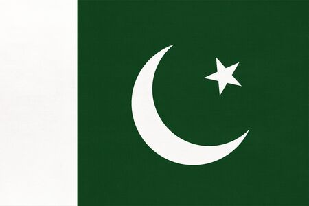 Republic of Pakistan national fabric flag with emblem, textile background. Symbol of international world asian country. State official Pakistani sign.