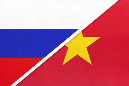 Russia or Russian Federation vs Socialist Republic of Vietnam national flag from textile. Relationship, partnership and economic between two european and asian countries.