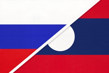 Russia or Russian Federation vs Laos national flag from textile. Relationship, partnership and economic between two european and asian countries.