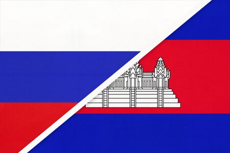 Russia or Russian Federation vs Kingdom of Cambodia national flag from textile. Relationship, partnership and economic between two european and asian countries.