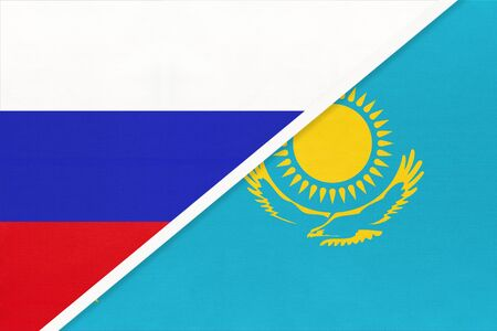 Russia or Russian Federation vs Republic of Kazakhstan national flag from textile. Relationship, partnership and economic between two european and asian countries.