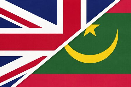 United Kingdom of Great Britain and Ireland or UK vs Islamic Republic of Mauritania national flag from textile. Relationship, partnership and economic between two European and African countries.