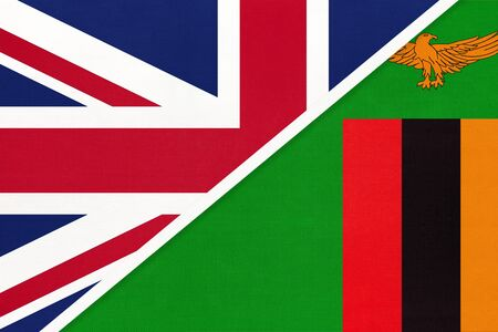 United Kingdom of Great Britain and Ireland or UK vs Republic of Zambia national flag from textile. Relationship, partnership and economic between two European and African countries.