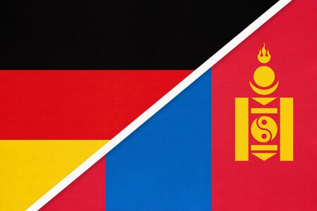 Federal Republic of Germany vs Mongolia, symbol of two national flags from textile. Relationship, partnership and championship between European and Asian countries.