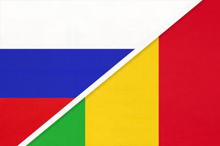 Russia or Russian Federation vs Republic of Mali, symbol of two national flags from textile. Relationship, partnership and championship between Asian and African countries. Banco de Imagens